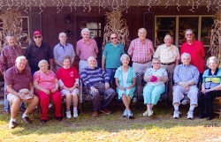 Sixteen member of the class of 1950, some seated, some standing.