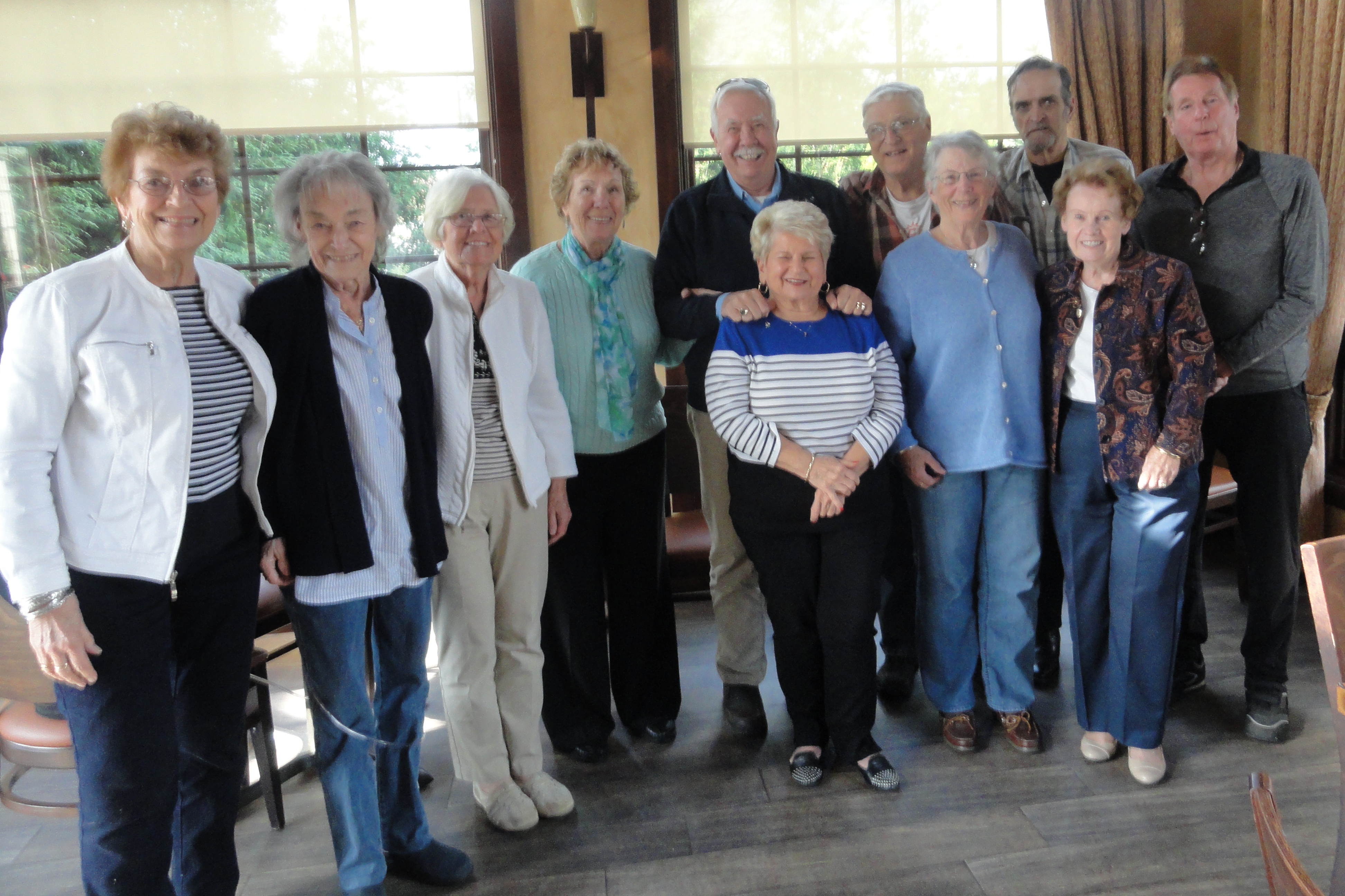 The Class of 1959 reunion committee standing as a group.