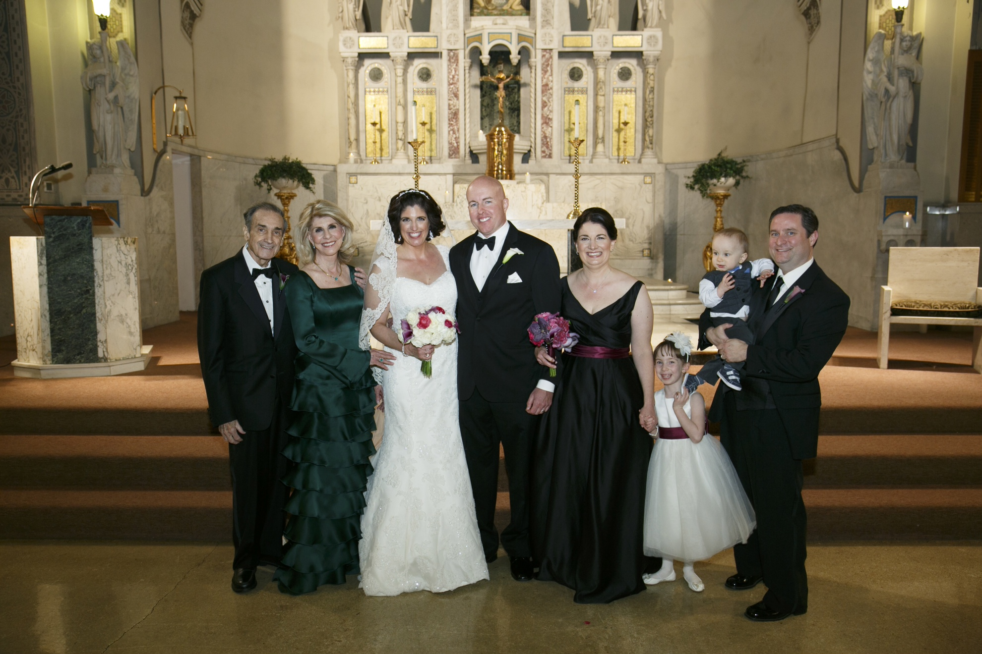 Kathleen Driscoll Amatangelo Class of 1958 posing on the altar with her family at her daughter Holly's wedding at the Shrine of Our Lady of Pompii in Chicago, Illinois.